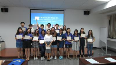 Ms. Guo Ting and students have group photo taken after awarding certifications